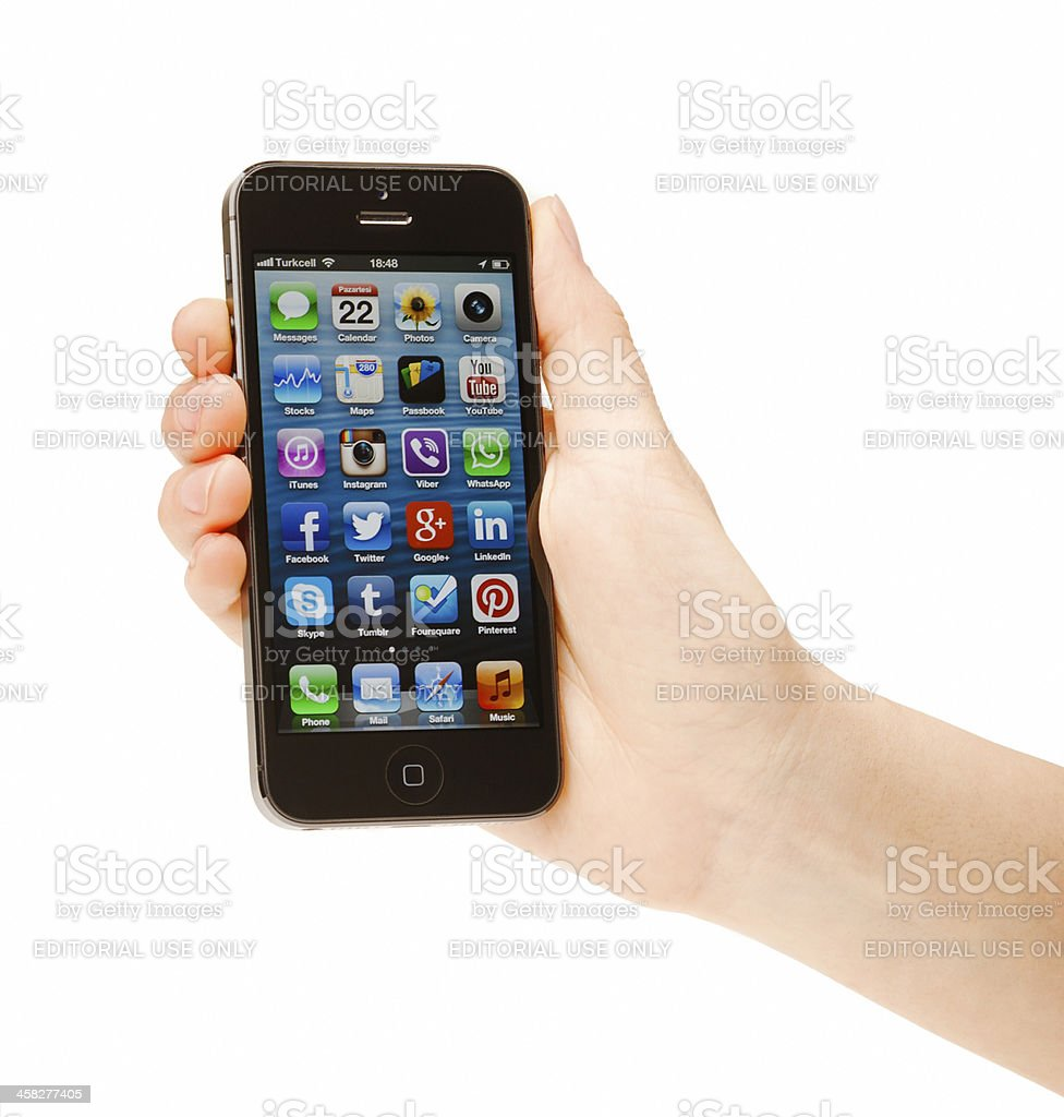 Hand holding New iPhone 5 stock photo