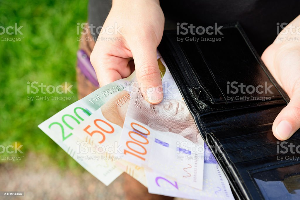 Hand holding new swedish bank notes wallet. NOTE: 2015 model. stock photo