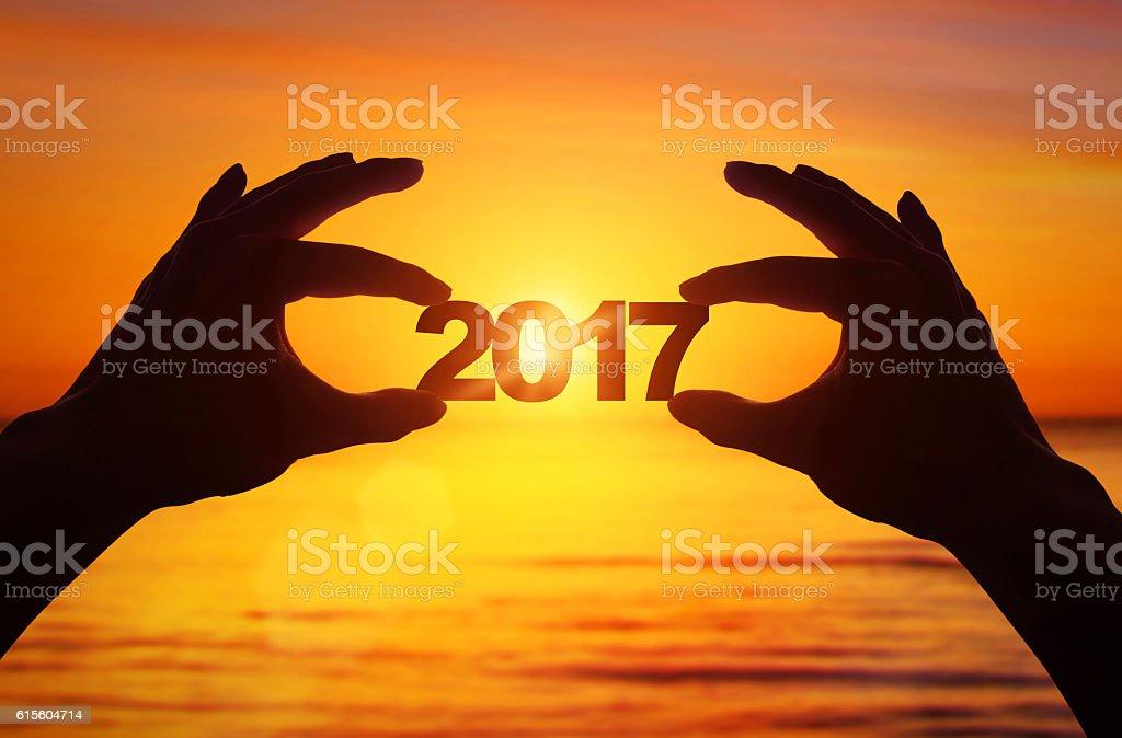 Hand holding new year 2017 stock photo