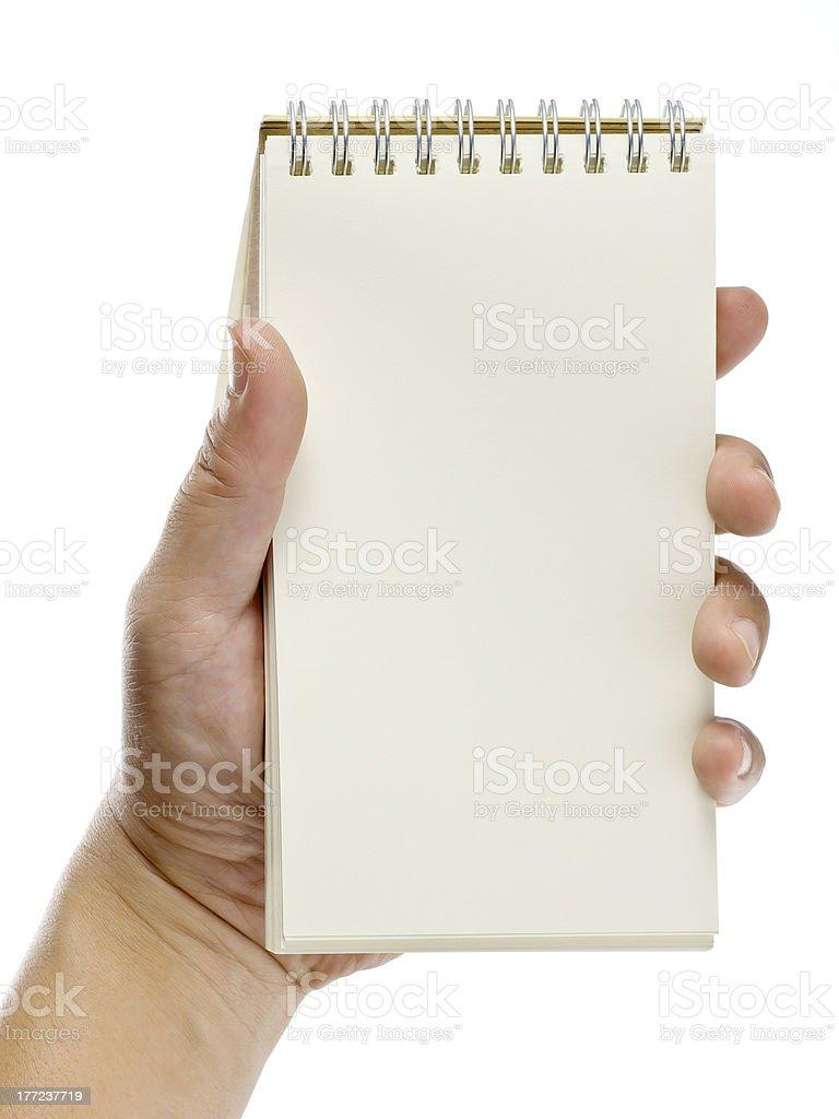 hand holding notebook, isolated on white background stock photo