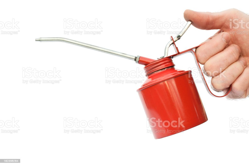 Hand holding oil can isolated on white royalty-free stock photo