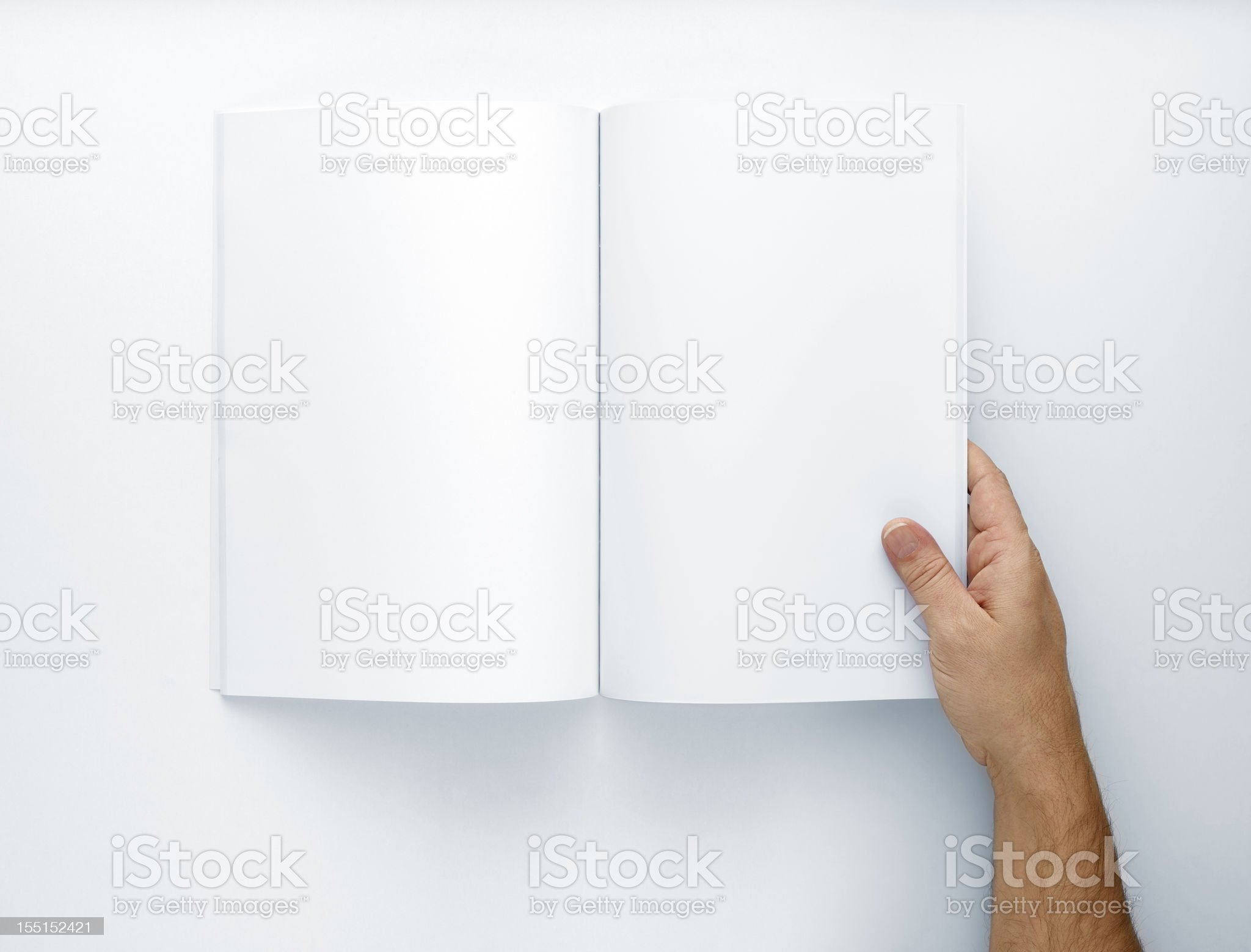 Hand Holding Open A Blank Magazine royalty-free stock photo
