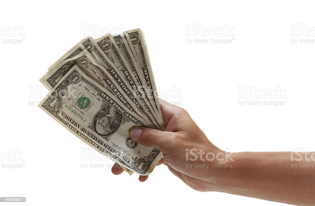 Hand holding out some worn dollar bills stock photo