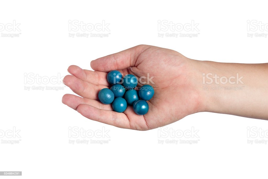 Hand Holding Paint Balls stock photo