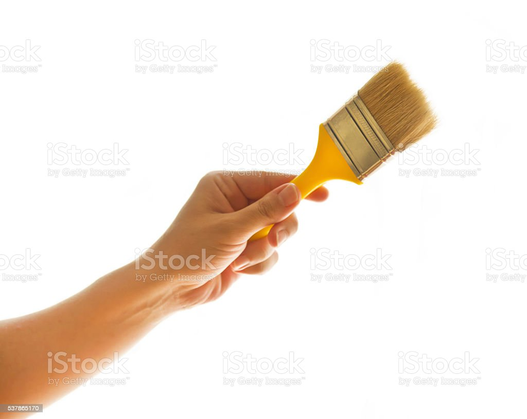 Hand holding paint brush stock photo