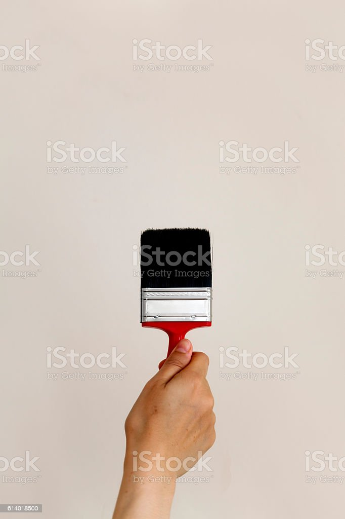 Hand holding paint brush stock photo
