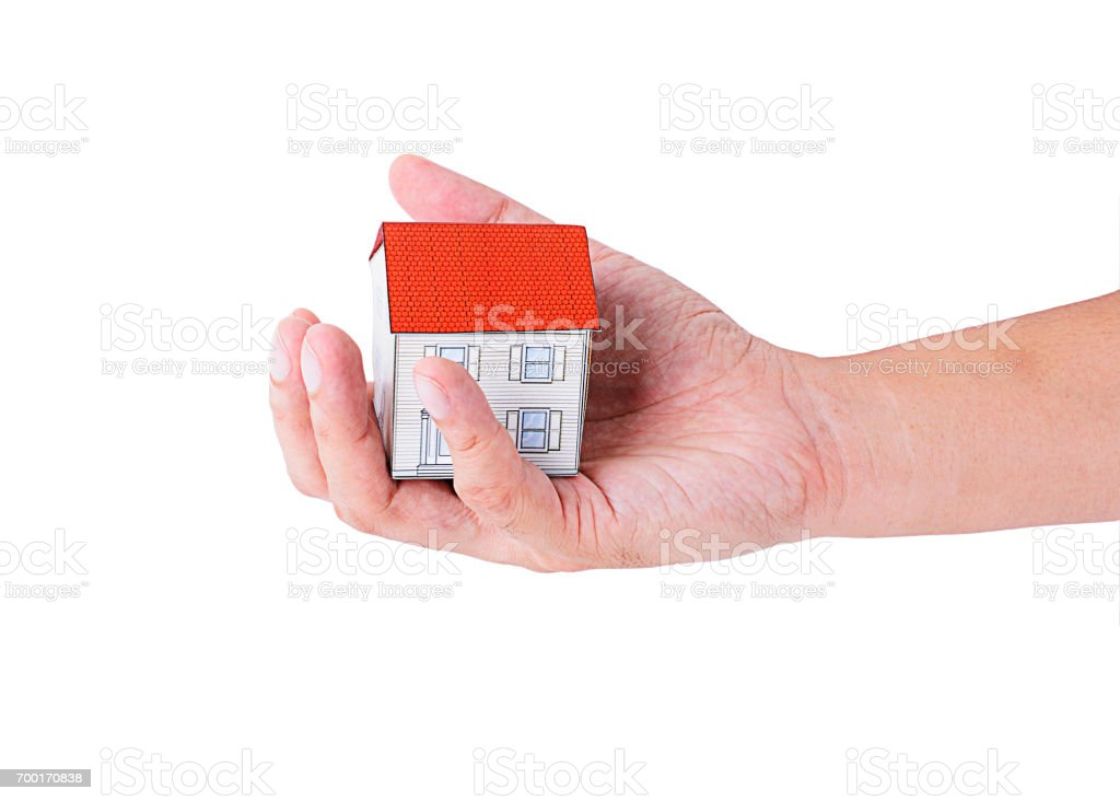 Hand holding paper house model Isolated on white backgrounds stock photo
