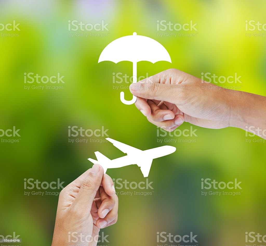 Hand holding paper on green background, Travel Insurance stock photo