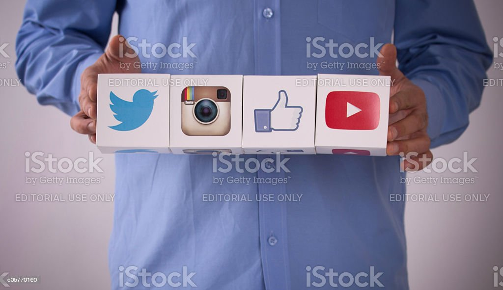 Hand Holding Paper Social Media Cubes stock photo