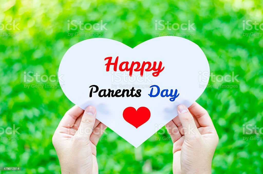 Hand holding paper with Happy Parents day text stock photo