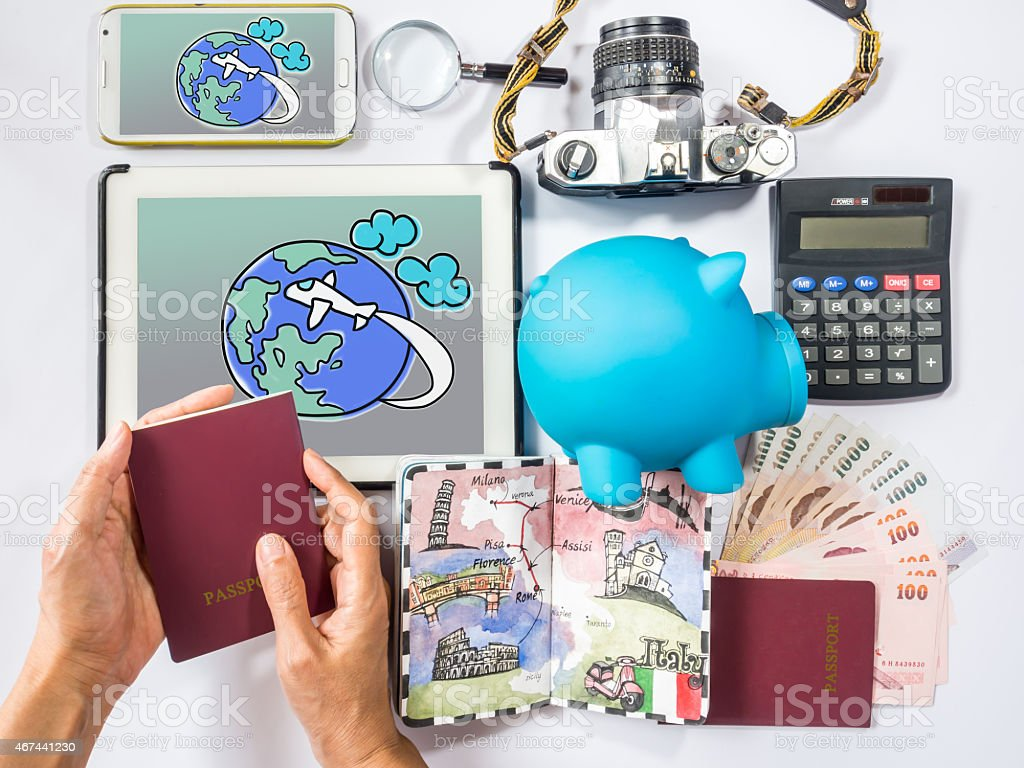 Hand holding passport-book planning for dream destination/ traveling saving concept stock photo