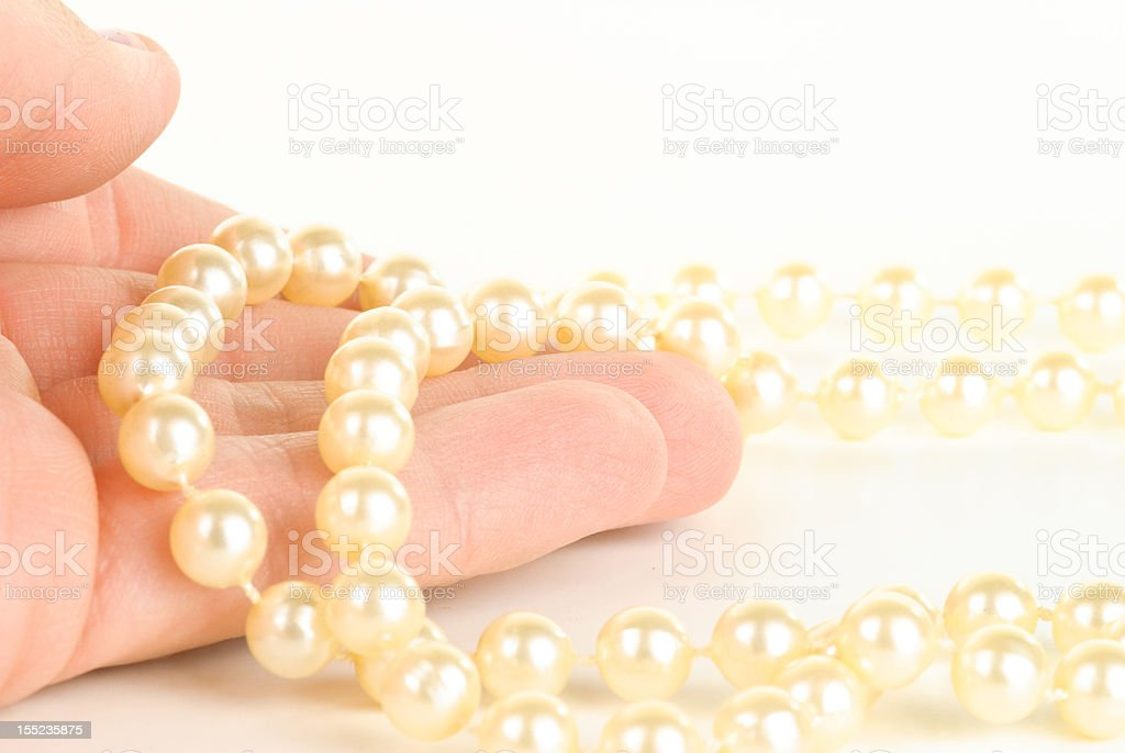 Hand Holding Pearls stock photo
