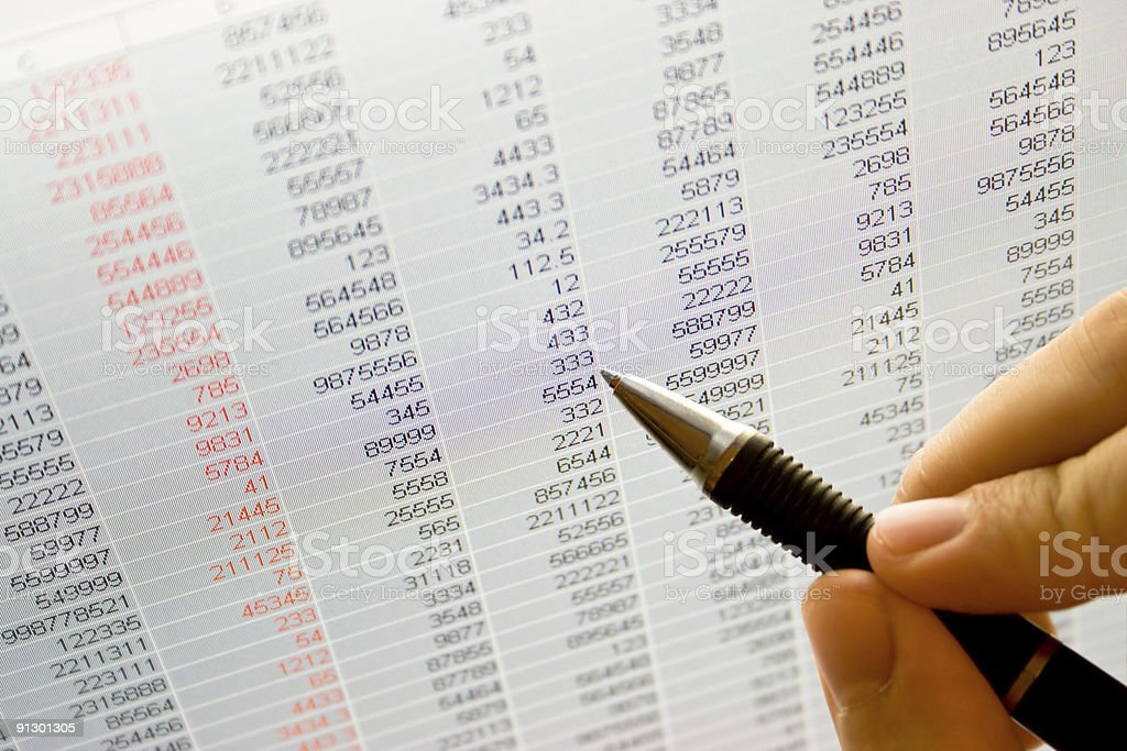 Hand holding pen and pointing to stock market analysis royalty-free stock photo