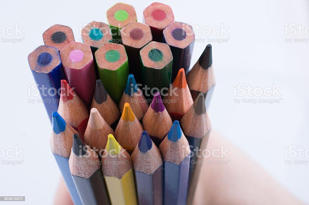 Hand holding pencils stock photo