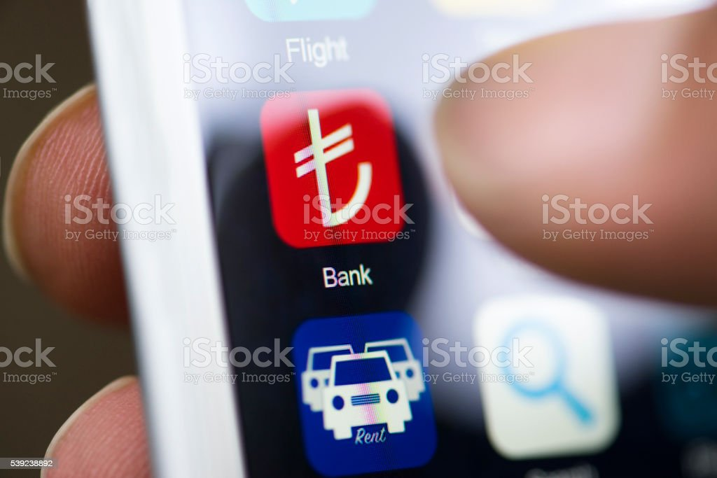 Hand holding phone, banking app on screen stock photo