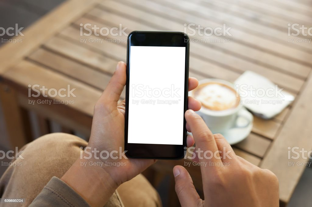 hand holding phone blank screen and finger touching stock photo