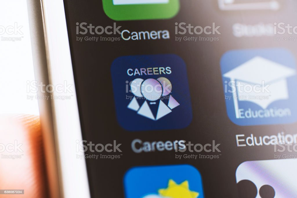 Hand holding phone, touching job search app stock photo