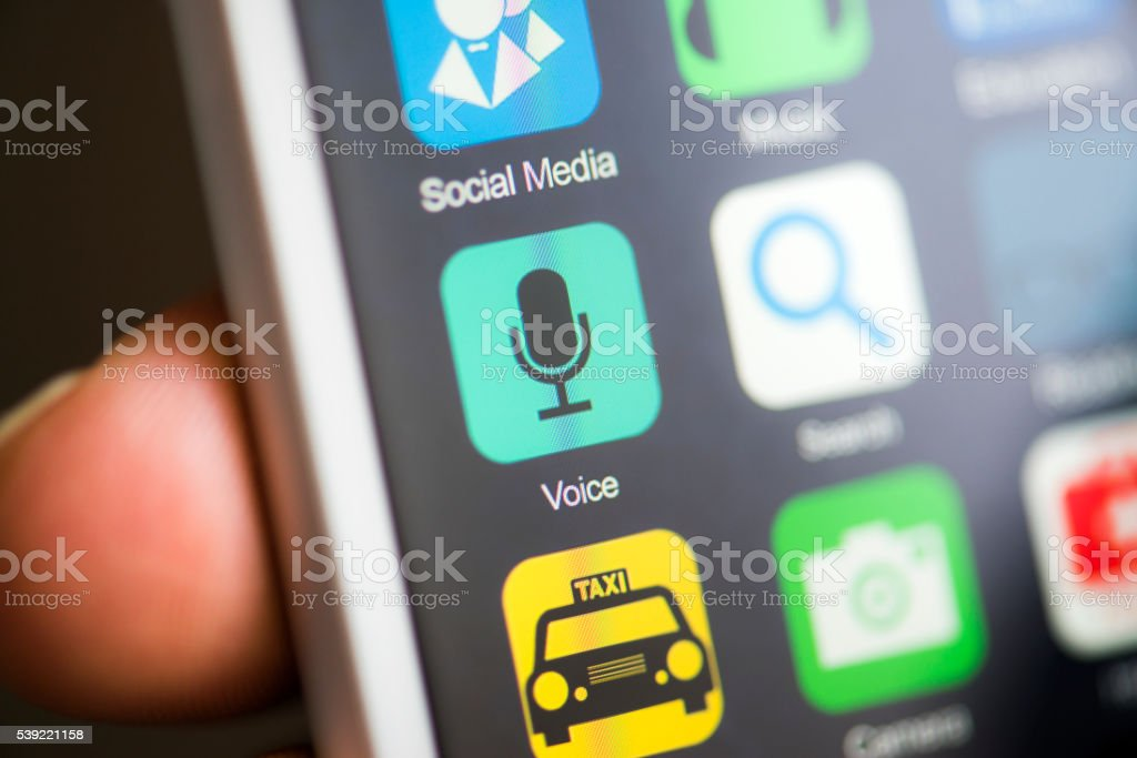 Hand holding phone, voice record app on screen stock photo