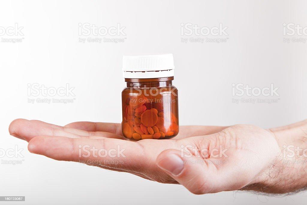 Hand Holding Pill Bottle stock photo