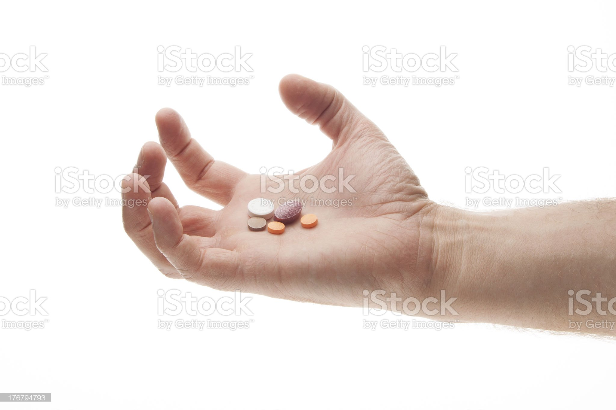 Hand holding pills in an angry or frustrated manner royalty-free stock photo