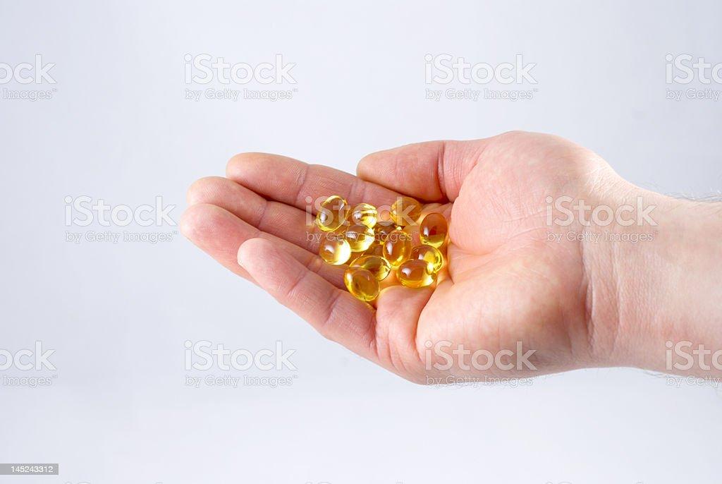 Hand Holding Pills royalty-free stock photo
