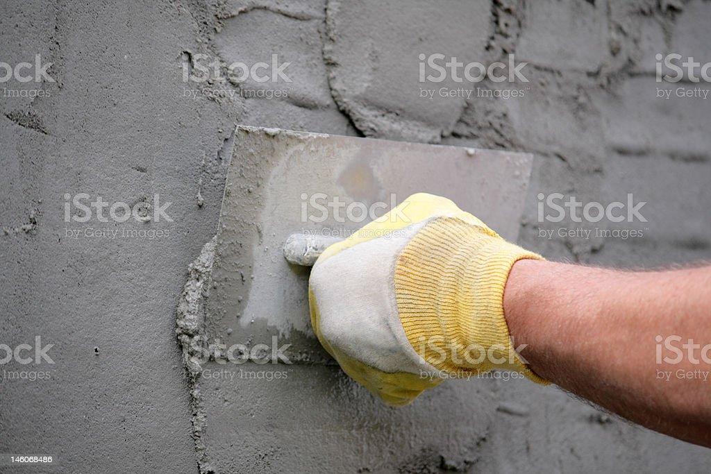 Hand holding plastering tool stock photo
