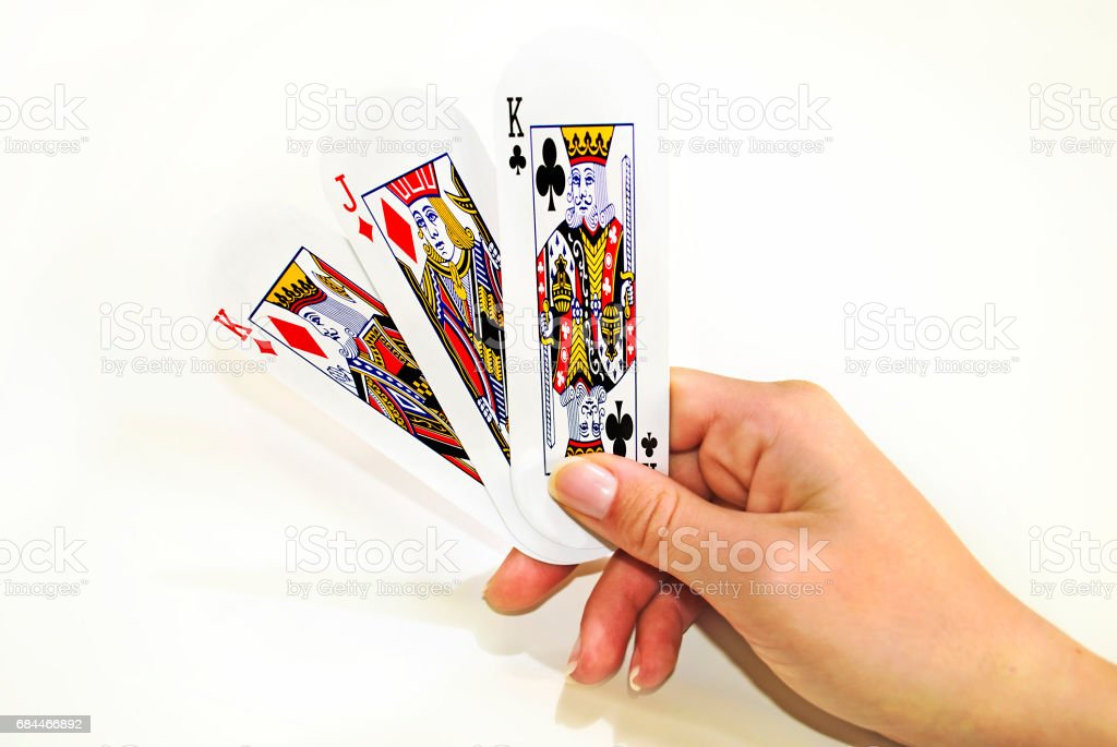hand holding playing cards stock photo