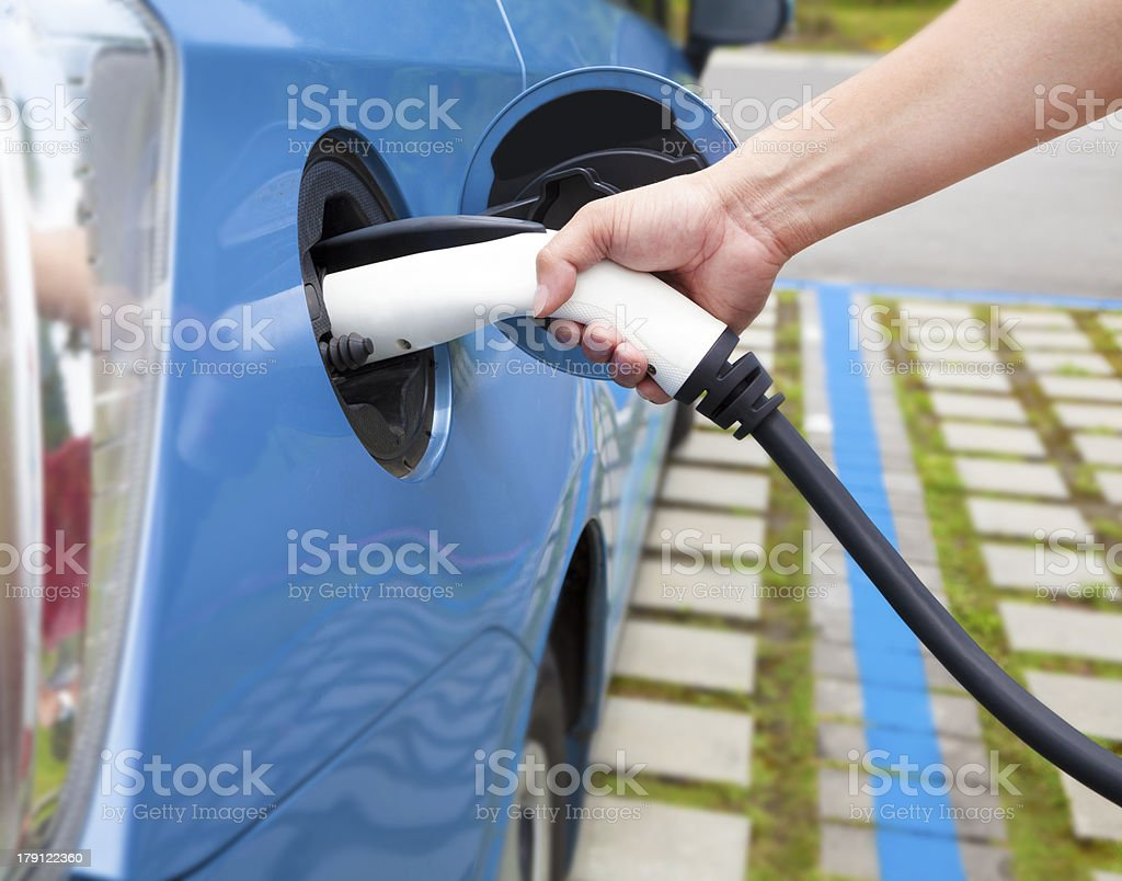 hand holding plug for Charging electric car royalty-free stock photo