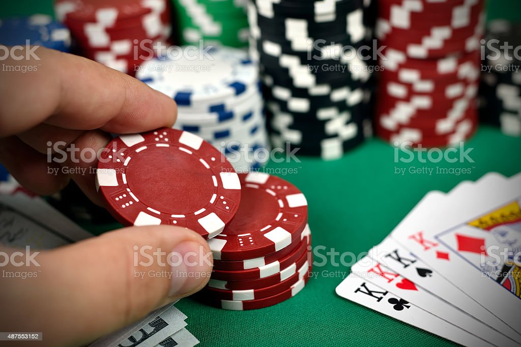 hand holding poker chips stock photo