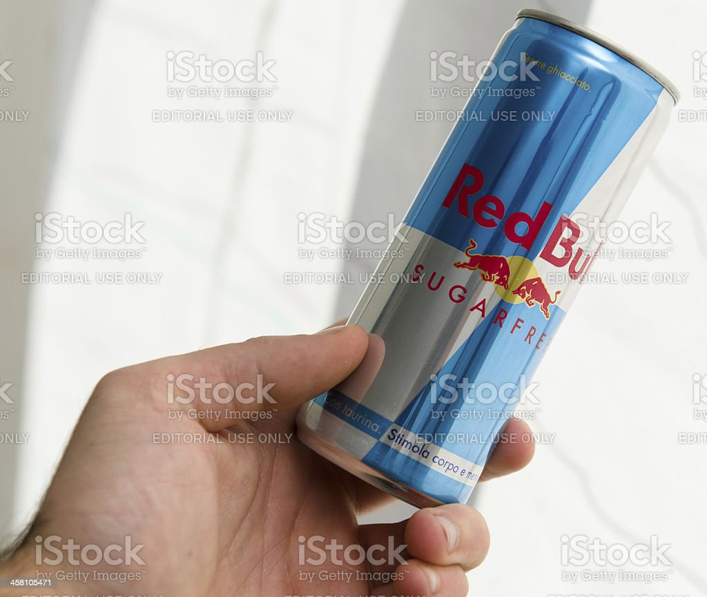 Hand holding Red Bull light Cans stock photo