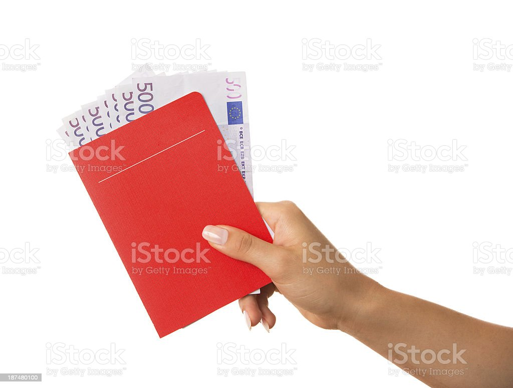 Hand holding red savings book with many 500 Euro notes stock photo