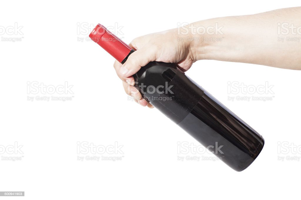 Hand holding red wine bottle royalty-free stock photo