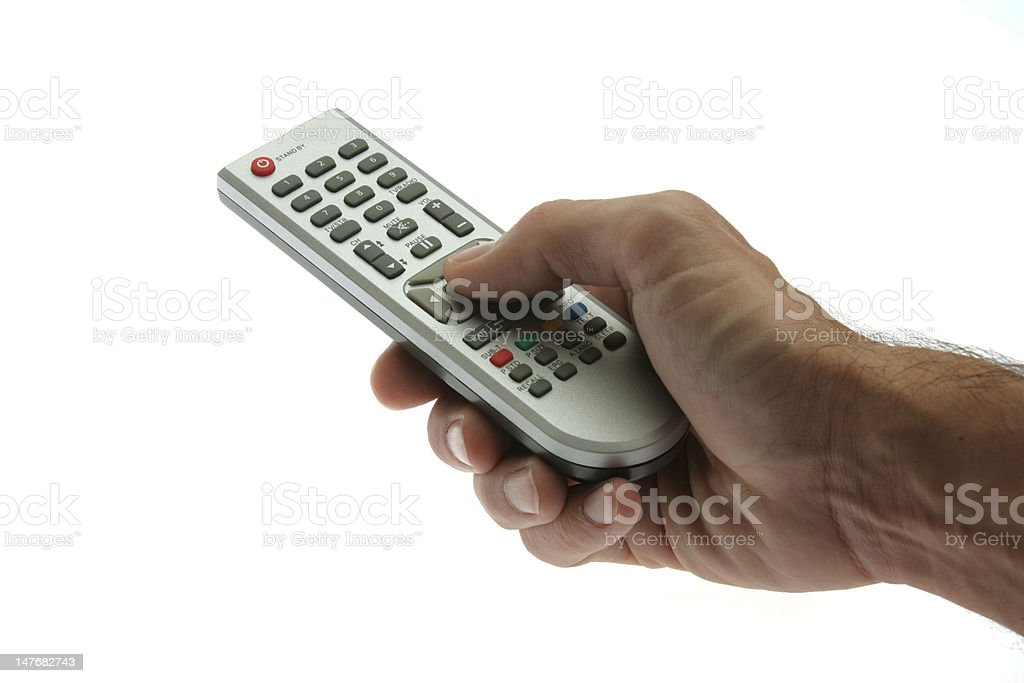 hand holding remote control royalty-free stock photo