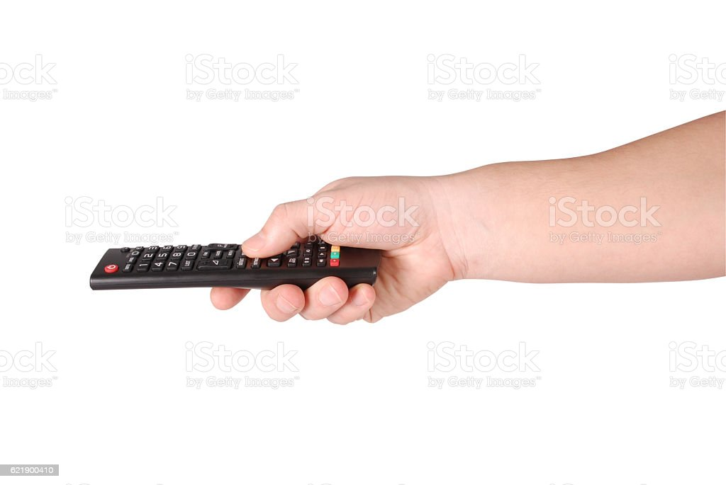 Hand holding remote control (Clipping path) stock photo