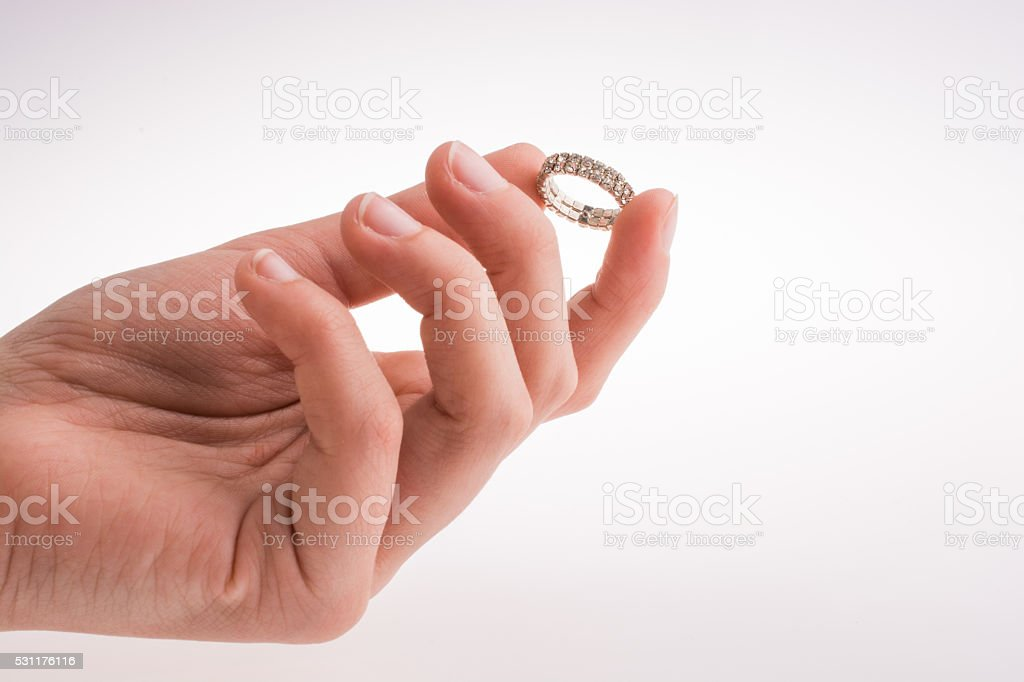 Hand holding ring stock photo