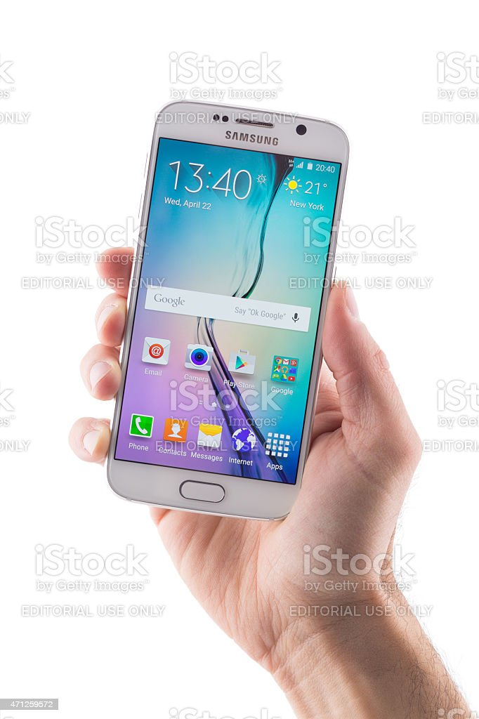 Hand holding Samsung Galaxy S6 with clipping path on display stock photo