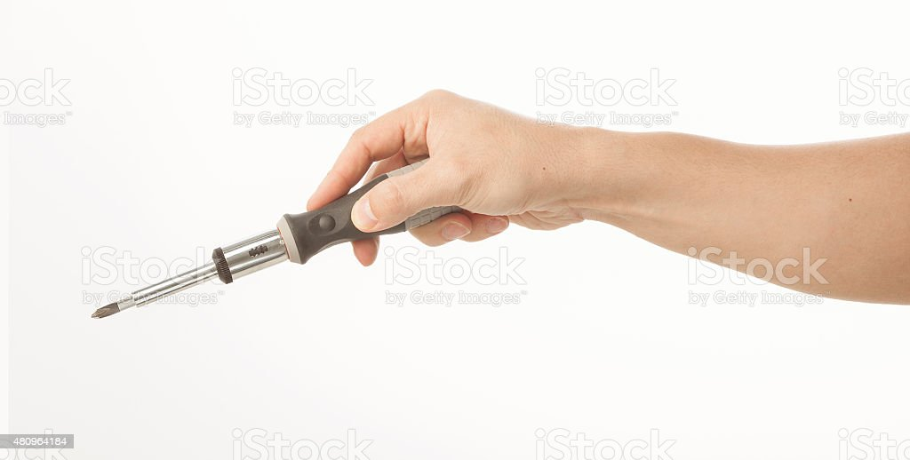 Hand holding screwdriver on white stock photo