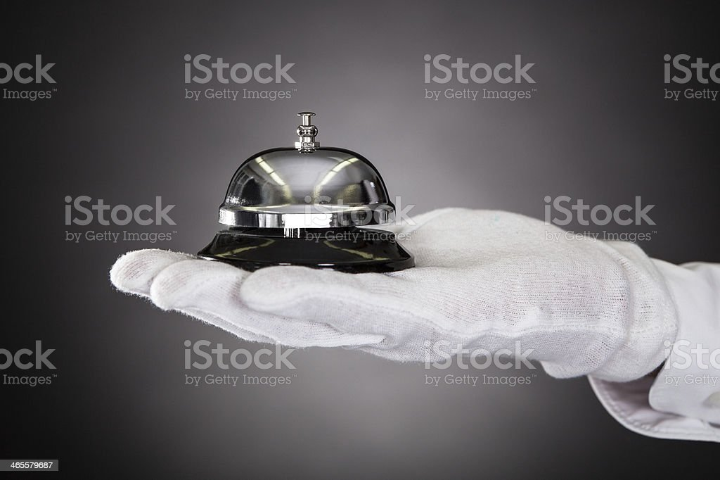 Hand Holding Service Bell stock photo