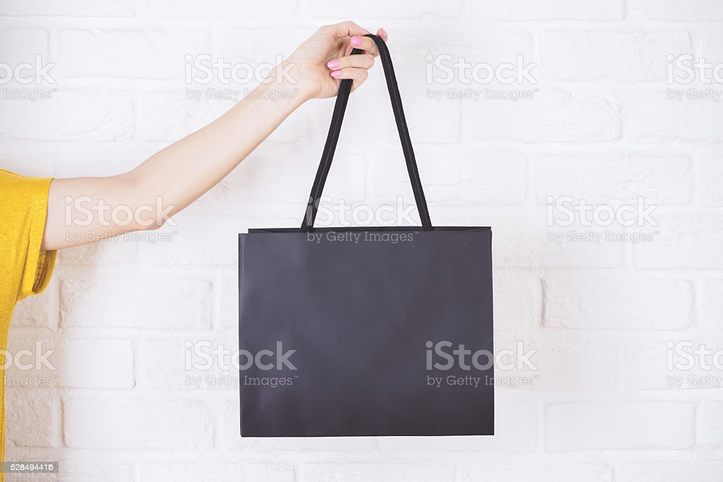 Hand holding shopping bag stock photo