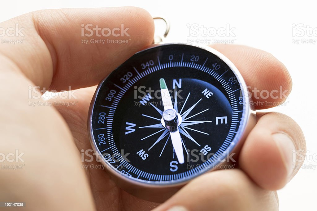 Hand holding silver black compass royalty-free stock photo