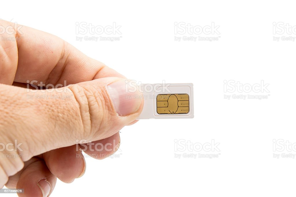 Hand holding sim card isolated on white background stock photo