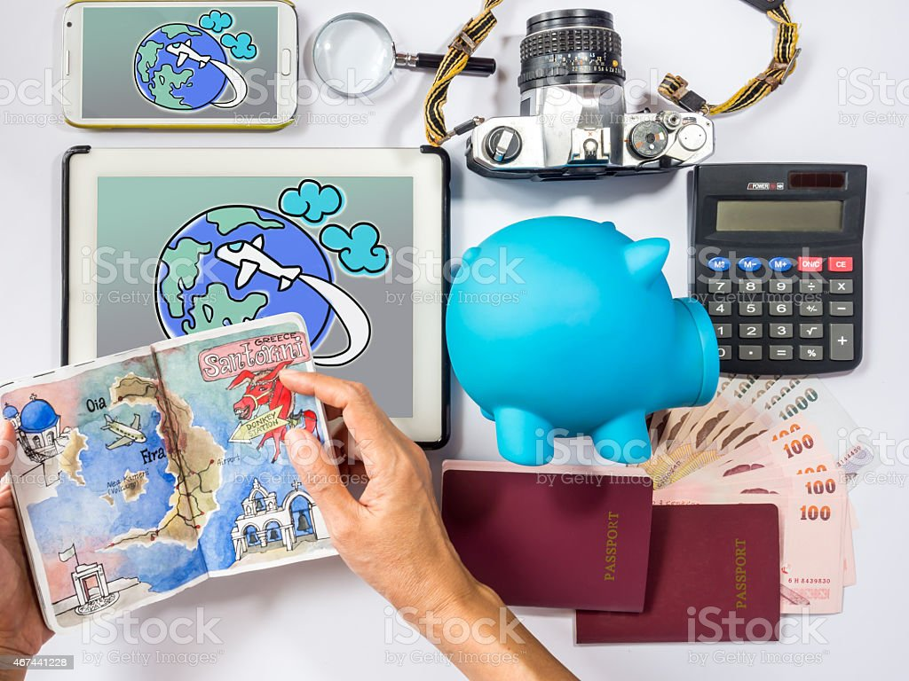 Hand holding sketch book of dream destination/ traveling saving concept stock photo