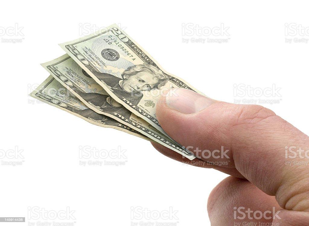 Main tenant une petite note de 20 $ photo libre de droits