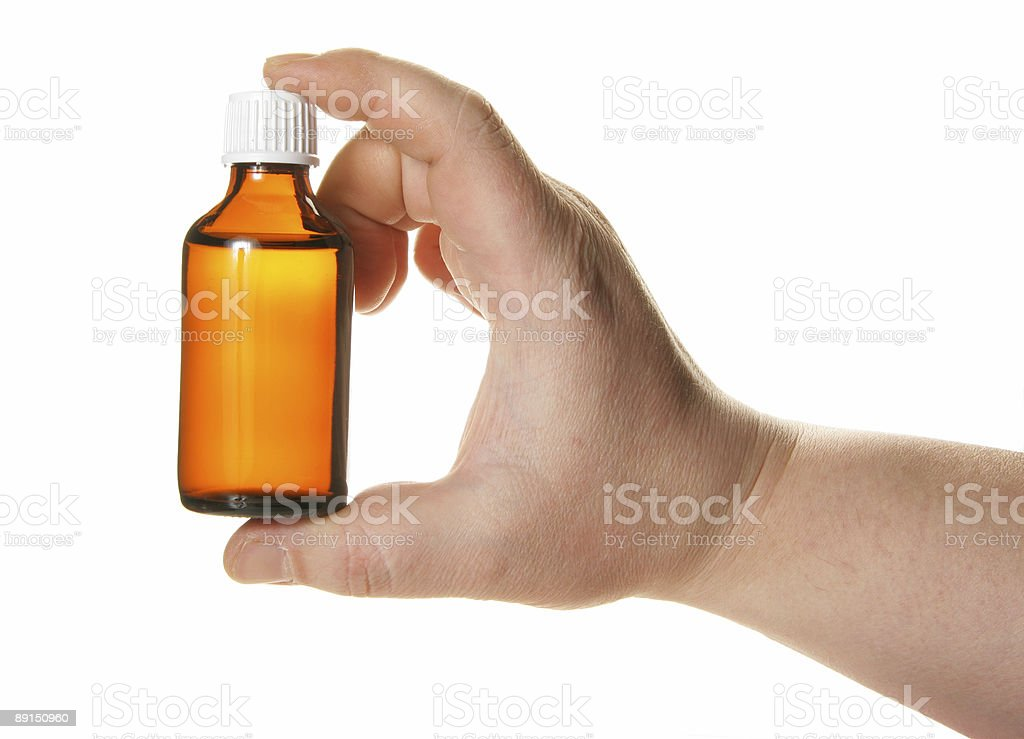 Hand holding small bottle with drug stock photo