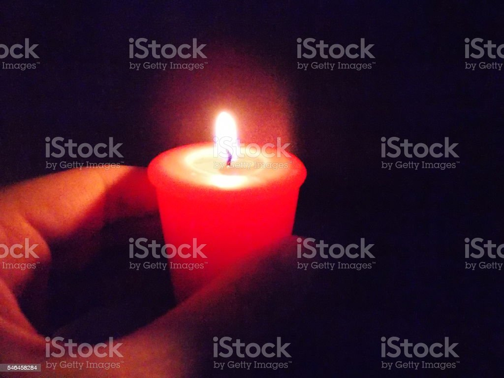 Hand Holding Small Red Candle stock photo