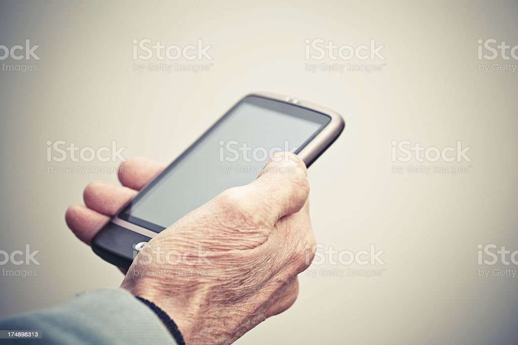 Hand holding smart phone royalty-free stock photo