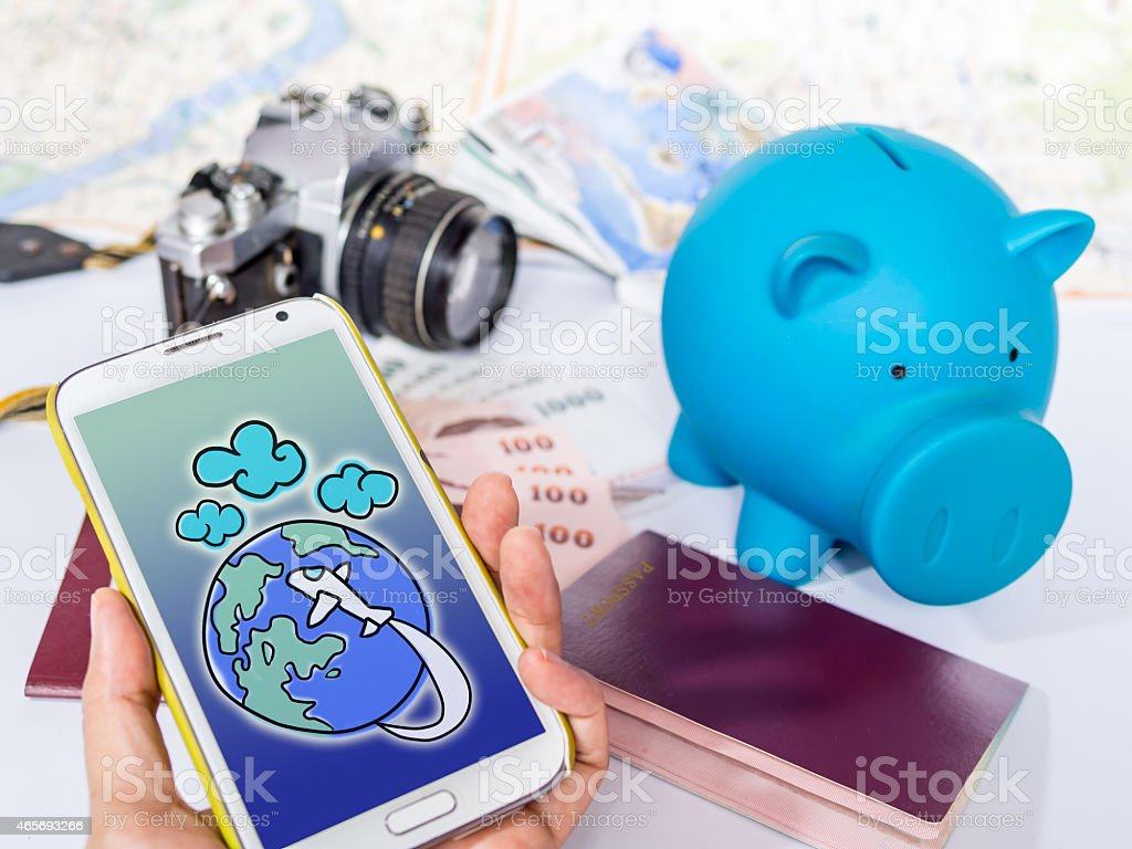 Hand holding smart phone , searching for dream destination/ traveling concept stock photo