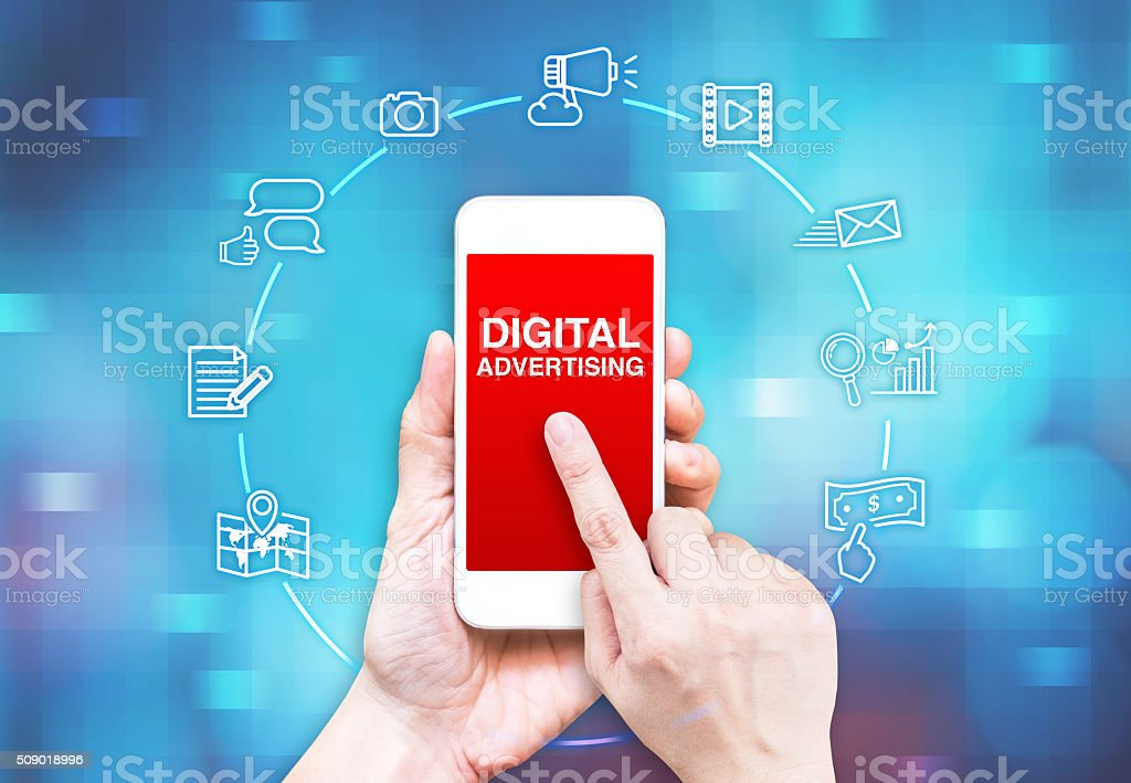 Hand holding smart phone with Digital Advertising word and icon stock photo