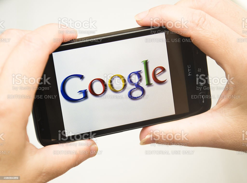 hand holding Smart phone with Google logo stock photo
