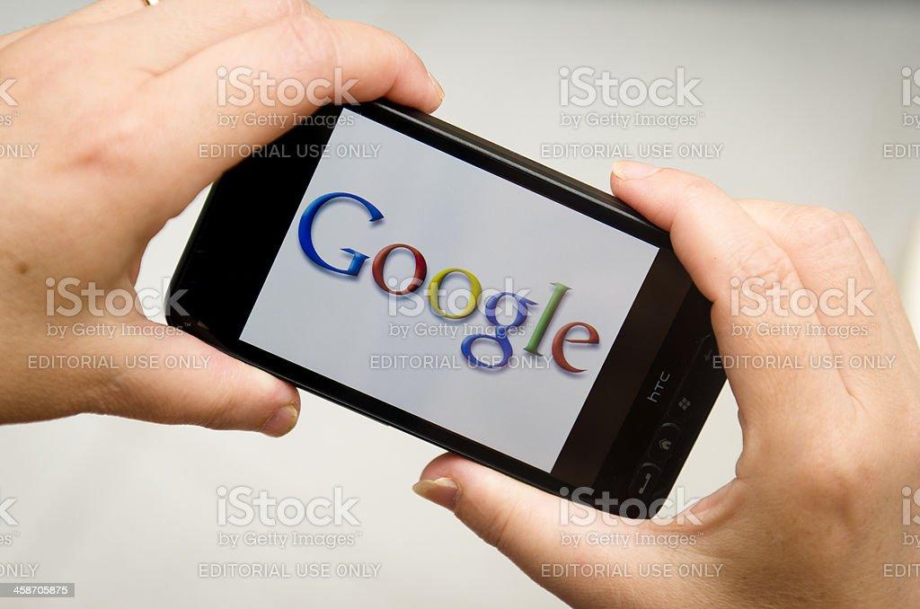 hand holding Smart phone with Google logo stock photo
